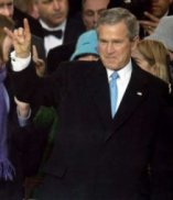 President George Bush flashing the devil's horn hand signal.